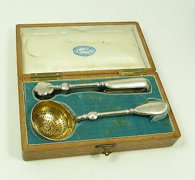 Russian  Imperial  Silver  Tea  Strainer  And  Tongs  Set