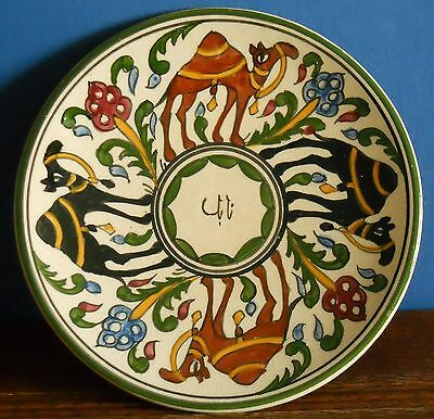 """A charming vintage 7"""" studio wall plaque with hand painted camels"""