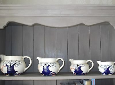 Made in England  HAND PAINTED Set Of Four Very Old Jugs Collectable