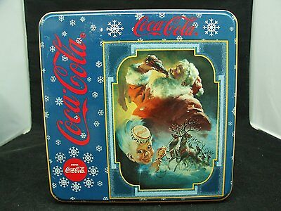 Coca cola christmas puzzle in a tin