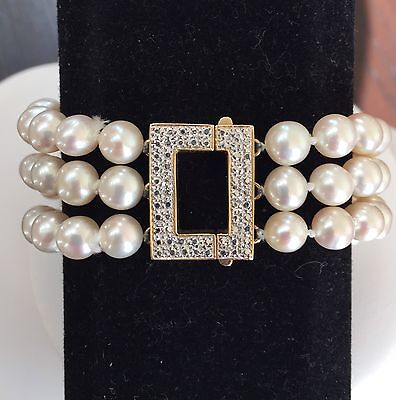 Triple strand genuine pearl bracelet with 14k yellow gold diamond cut square cla