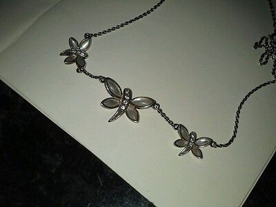 Solid silver butterfly necklace set with mother of pearl and clear faceted stone