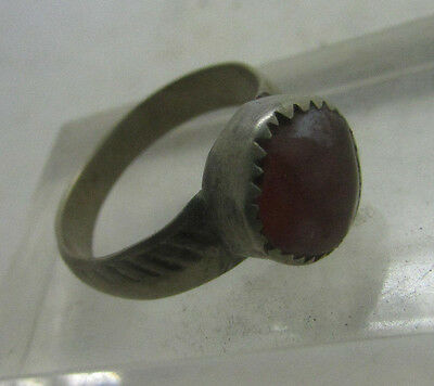 Old silver ring with orange stone