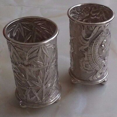 PAIR OF ANTIQUE CHINESE SILVER POTS.  50.5 mm HIGH.  WEIGHT OF PAIR IS 39 GRAMS.
