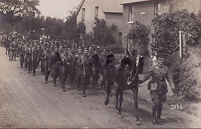Soldier group Royal Engineers on route march through unidentified village