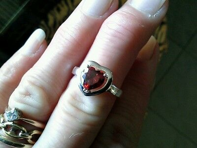 Solid silver ring set with genuine heart shaped faceted garnet unused