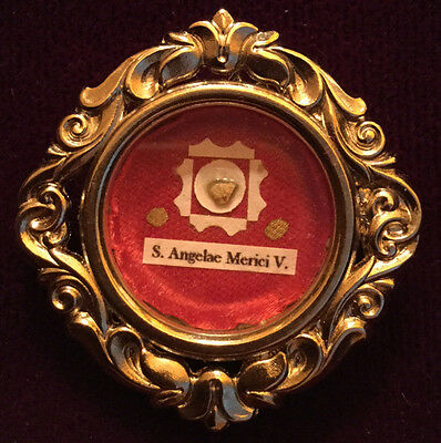 First class relic of St. Angela Merici. Postulator seal and threads are intact!