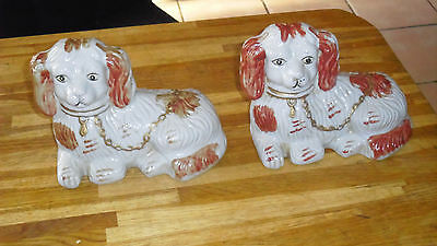 2 porcelain  spainel dogs