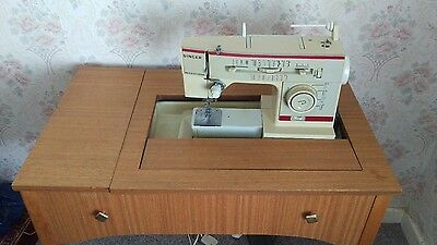 Singer sewing machine and table full working order.