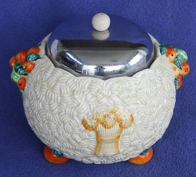 "Clarice Cliff ""Celtic Harvest"" biscuit barrel with a chrome cover"
