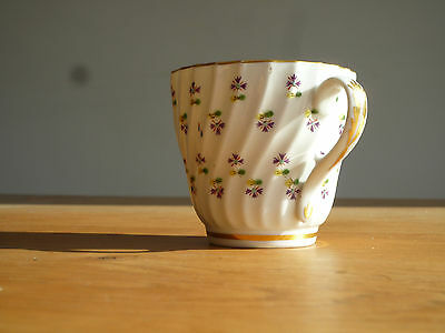Victorian fluted coffee/tea cup with floral and gold design