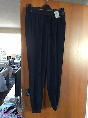 TU black trousers size 12-14 new with tags