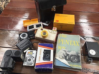Assorted Vintage Cameras And Paraphernalia Flashes , Lenses, Hand Held Cameras
