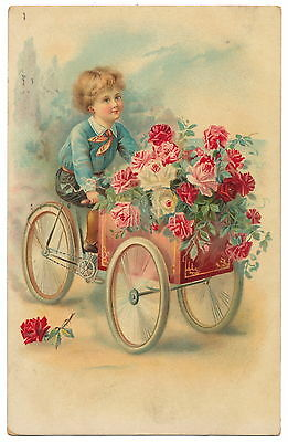 Tuck - Beautiful Little Boy Pedaling a Cart Brimming with Roses