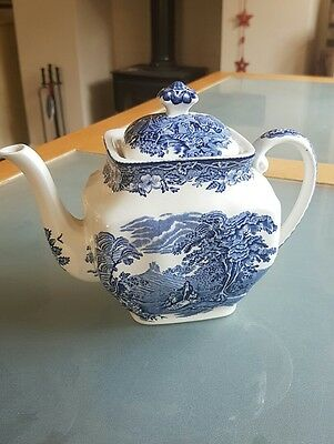 """Vintage blue and white teapot with """"made in England"""" embossed underneath"""