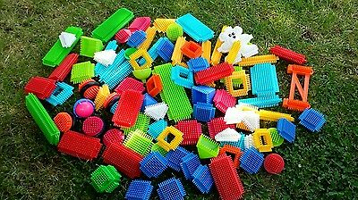 large set of sticklebricks over 90 pieces including spinning wheels