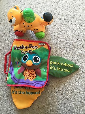 Two baby toys one Lamaze book and one push along cheetah