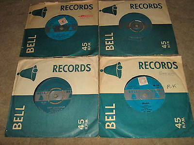 Four 45RPM records on 1950s Bell label mono