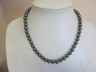 Knotted Faux Pearls In Gun Metal Color