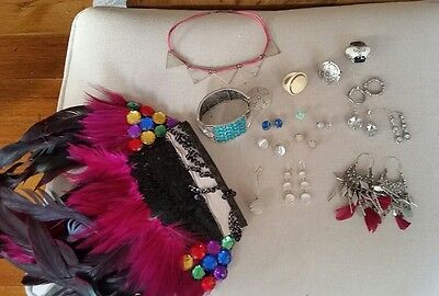 A hell of the lot! All sorts of jewellery! Earrings, feathers, silver, rings etc