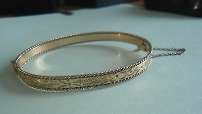 9K ROLLED GOLD BEADED EDGE  ENGRAVED PATTERN BANGLE  10grams  (sold as seen)