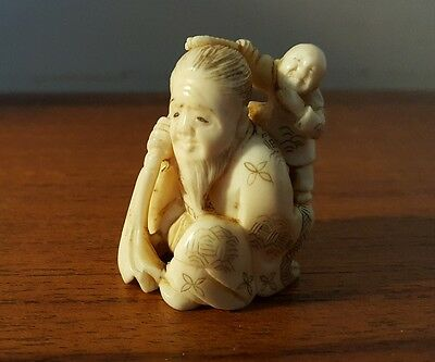 Japanese Meiji period Netsuke of Hotei with child - Signed