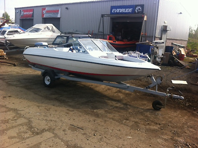 speedboat with engine and trailer