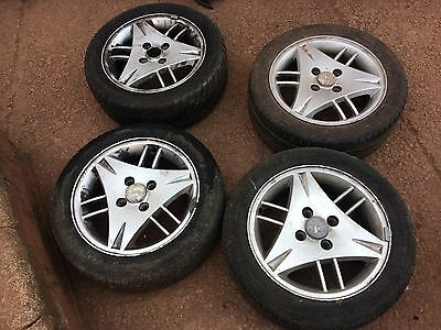 "Ford escort set of 15"" alloy wheels and good tyres"