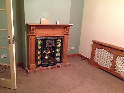 Pine fire surround and cast iron fire place