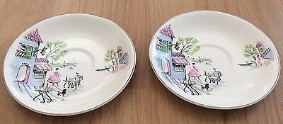 Pair of Alfred Meakin 'Down by the Seine' saucers