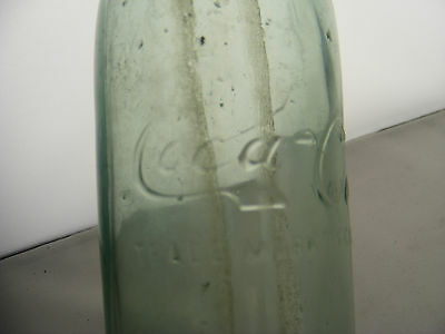 straight sided coca cola bottle center script