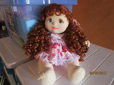 My child doll girl with curly red hair