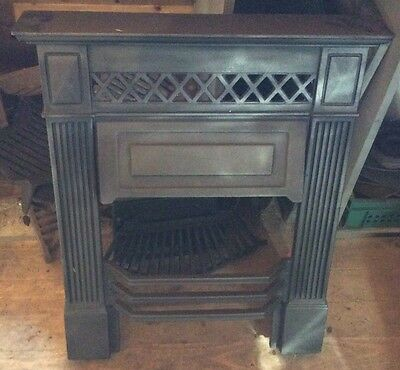 Pretty little Cast Iron fireplace surround with mantlepiece
