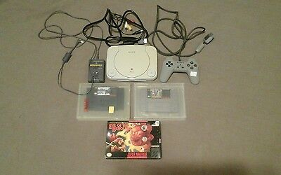 PsOne (slim) console and Snes game lot