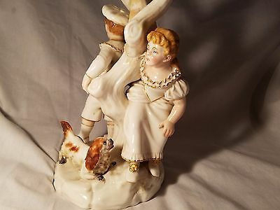 PORCELAIN CANDELABRA Tree form with figures of a Boy and Girl playing Hide Seek