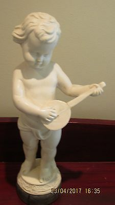 Figurine Of A Boy With Instrument