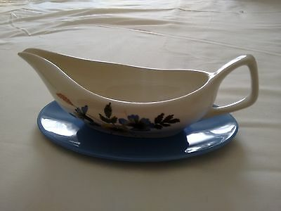 staffordshire sauce or gravy boat and stand