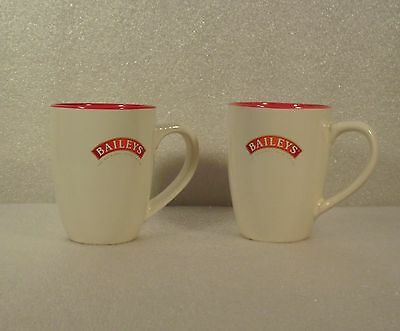 Pair of Baileys Irish Cream Mugs, Red Insides, signed R A Bailey on Back