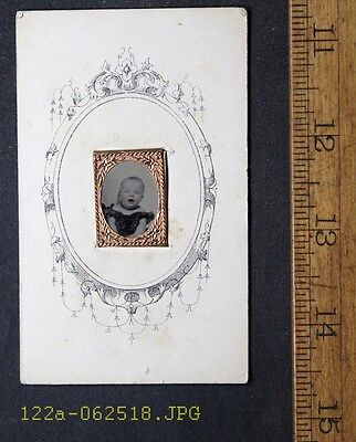 Antique Tintype Photo Baby with Open Mouth Head Held in Hand on Paper Frame