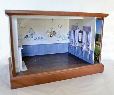 Shadow Box With Blue Oriental Wallpaper And Built In Fireplace