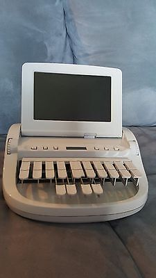 Stenograph Wave Student Writer with carrying case, roller bag, and other items