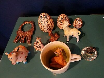 Lot of giraffe collectibles/ figurines- nesting dolls, magnifying glass, perfume