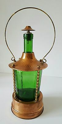 Vintage German copper & brass green glass sherry decanter with musical box