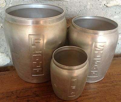 Vintage Aluminium Kitchen Canisters, would make great vases