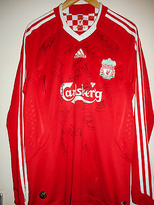 Liverpool signed football shirt by 2009 superstar squad with COA