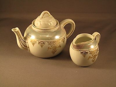 Vintage Made In Japan Child's Lusterware Toy Tea pot and creamer Set