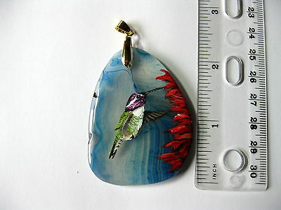 costas hummingbird pendant on agate