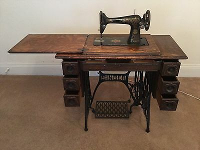 Early Century Singer Treadle Sewing Machine And 7 Drawer Tiger Wood Cabinet