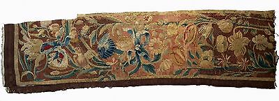 A 17th Century Tapestry Fragment with Ribbon, Flowers and 2 Birds