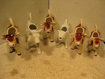 Nice Herd of 6 ceramic cow creamers